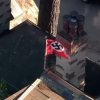 Man flying Nazi flag gets earful from neighbor related to Holocaust survivors